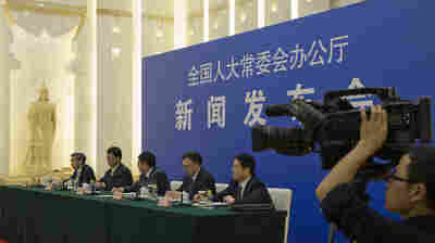 "Chinese officials answer questions about a new law regulating overseas non-governmental organizations during a press conference at the Great Hall of the People in Beijing on Thursday. The new law subjects NGOs to close police supervision. ""We welcome and support all foreign NGOs to come to China to conduct friendly exchanges,"" one official said."