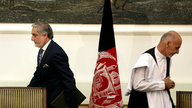 President Ashraf Ghani (right) and Chief Executive Abdullah Abdullah (left) leave after signing a power-sharing deal in September 2014 at the presidential palace in Kabul. Afghanistan's National Unity Government is now in disarray. (AP)