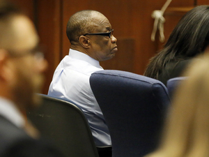 Defendant Lonnie Franklin Jr., left, listens during the opening statement in the trial which began on Feb. 16, 2016. Franklin was dubbed the Grim Sleeper for the serial murders that terrorized South LA.