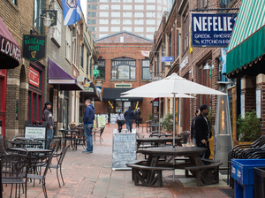 People have lunch in the French Quarter at Latta Arcade in uptown Charlotte, N.C.