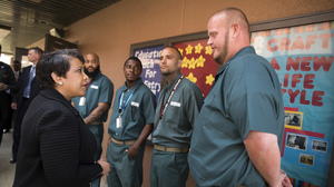 Attorney General Lynch talks with inmates, from left, Tobin Lyon, Bilal McElroy, Derrick Cash and Derek William Spinks, during a visit to Talladega Federal Correctional Institution on April 29, 2016.