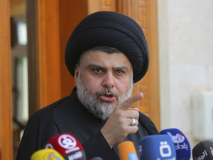 Shiite cleric Muqtada al-Sadr speaks during a media conference in Najaf, Iraq. Dozens of his supporters stormed the heavily fortified Green Zone in Baghdad on Saturday.