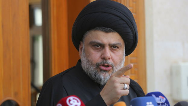 Shiite cleric Muqtada al-Sadr speaks during a media conference in Najaf, Iraq. Dozens of his supporters stormed the heavily fortified Green Zone in Baghdad on Saturday. (AP)