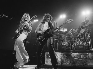Alex Lifeson (left) and Geddy Lee (with Neil Peart on drums) on stage in 1976 on the tour that followed the release of 2112.