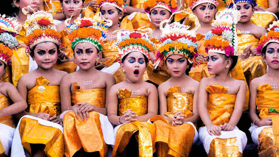 A yawn from one of the girls who'll perform a traditional dance at the Hindu Melasti Festival in Bali, Indonesia.