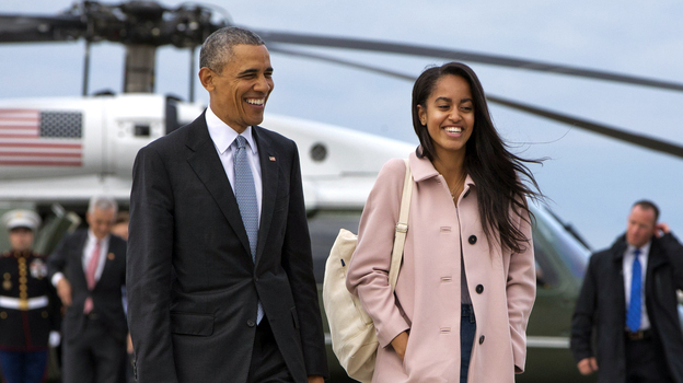 President Barack Obama jokes with his daughter Malia Obama as they walk to board Air Force One from the Marine One helicopter, as they leave Chicago en route to Los Angeles last month. (AP)