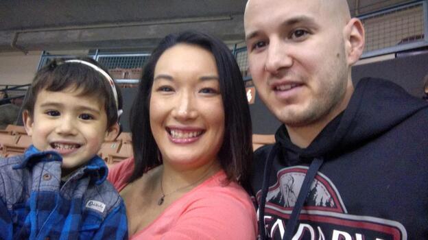 Nancy Glynn, her husband, Michael Gebo, and their son, Hunter, attend a minor league baseball game near their home in Manchester, N.H. (Courtesy of Nancy Glynn)