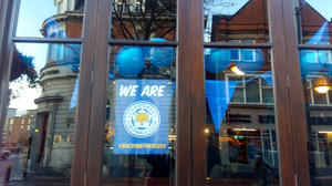 Shop and restaurant windows in Leicester's city center are adorned with 'Backing the Blues' posters, in support of the hometown soccer team, Leicester City.