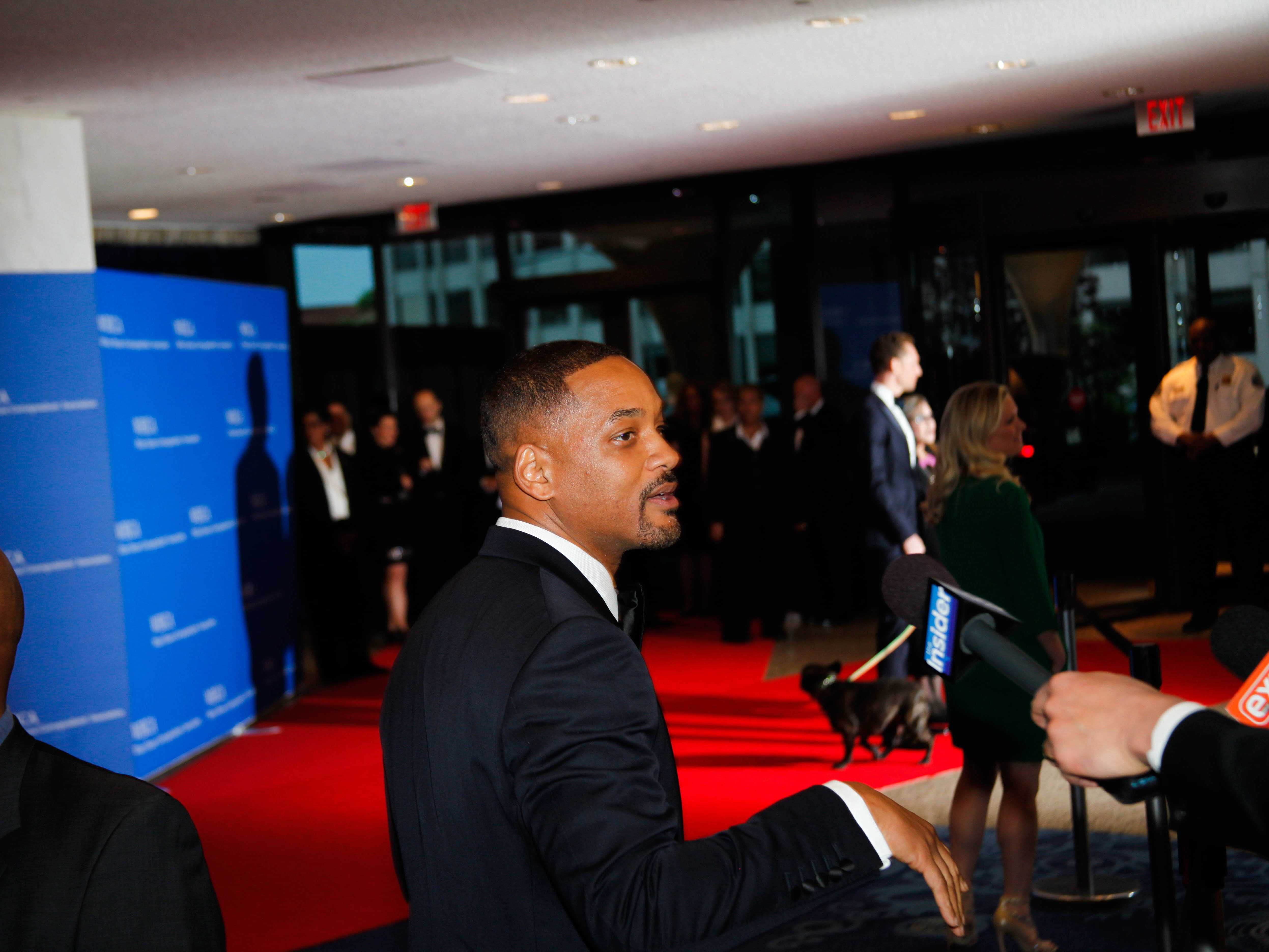 """Will Smith speaking to press on the red carpet ahead of the White House Correspondents' Association Dinner on Saturday in Washington, D.C.Party-goers take photographs at the Thompson-Reuters post-dinner event on Saturday in Washington, D.C.A couple exiting after the dinner events on Saturday in Washington, D.C.The scene as the Yahoo/ABC pre-dinner party opened, which as it was the first party of the evening was the first stop for many dinner guests ahead of the 102nd White House Correspondents' Association Dinner on Saturday in Washington, D.C.Shonda Rhimes speaking with Former Secretary of State Madeleine Albright while surrounded by on-looking guests at the ABC/Yahoo party before the 102nd White House Correspondents' Dinner on Saturday in Washington D.C.Actor Tony Goldwyn leans over the bar during a crowded party leading up to the White House Correspondents' Association Dinner on Saturday in Washington D.C.The scene from the Yahoo/ABC pre-party ahead of the 102nd White House Correspondents' Dinner on Saturday, April 30th in Washington, D.C.Fans and staff wait for a glimpse of celebrities exiting after in the lobby of the Washington Hilton on Saturday in Washington, D.C.One car in President Obama's motorcade leaving the Washington Hilton after the White House Correspondents' Association Dinner on Saturday in Washington, D.C.Dinner guests after 102nd White House Correspondents' Association Dinner on Saturday, April 30 in Washington, D.C.Party-goers leave empty glasses (left) toward the end of a pre-party and Sen. Rand Paul and his wife (right) at a pre-party on Saturday.DJ Khaled and Arianna Huffington chatting with fans (L) and leaving the 102nd White House Correspondents' Association Dinner (R) on Saturday.The entrance to the Onion's """"Diamond Joe"""" party — one of the many events that followed the White House Correspondents' Association Dinner on Saturday in Washington, D.C.Will Smith speaking to press on the red carpet ahead of the White House Correspondents' Assoc"""