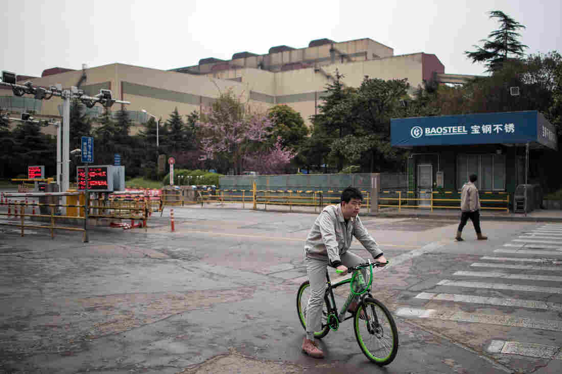 A worker leaves the Baosteel Group Corporation plant in Shanghai in March 2016.