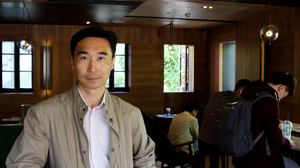 Larry Dong is tasked with opening 300 new Starbucks coffee shops in Shanghai and two neighboring provinces this year.