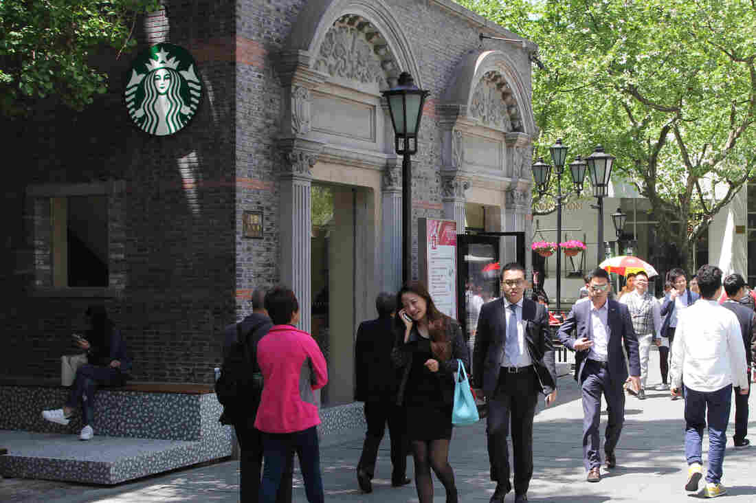 This coffee shop in Xintiandi, a pedestrian shopping area in Shanghai, is one of 450 Starbucks in the city. Shanghai has more Starbucks than any other city in the world, according to Larry Dong, who oversees operations for Starbucks shops in the city.