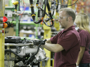 An engine is assembled at a Cummins plant in Columbus, Ind., in 2007. The Fortune 500 company sells diesel engines around the world.