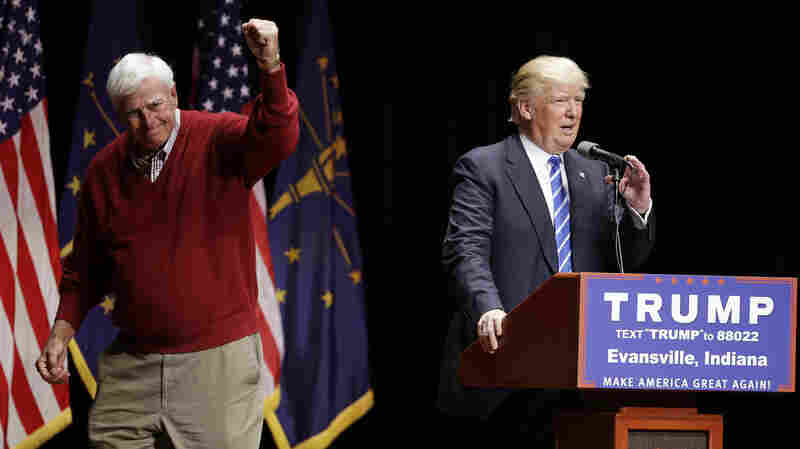 Former Indiana basketball coach Bob Knight raises his fist after talking about Republican presidential candidate Donald Trump during a campaign stop last week in Evansville, Ind.