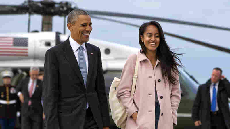 President Obama jokes with his daughter Malia as they walk to board Air Force One from the Marine One helicopter, as they leave Chicago en route to Los Angeles. The White House announced Sunday that Malia will take a year off after high school and attend Harvard University in 2017.