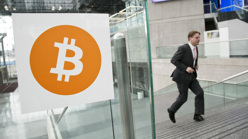 Entrepreneur Craig Wright says he is the creator of the bitcoin crypto-currency. In this 2014 file photo, a man arrives for the Inside Bitcoins conference and trade show in New York.