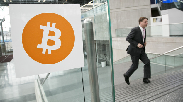 Entrepreneur Craig Wright claims that he is the creator of the Bitcoin crytpo-currency. In this 2014 file photo, a man arrives for the Inside Bitcoins conference and trade show in New York. (AP)