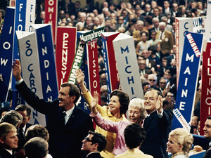 Vice President Hubert Humphrey (right) and his running mate, Sen. Edmund S. Muskie wave to the crowd with their wives at the Democratic Convention in Chicago on Aug. 29, 1968. Violence ensued inside and outside the convention hall.