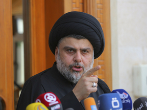 Shiite cleric Muqtada al-Sadr speaks in Najaf, Iraq, on Saturday. His supporters entered Baghdad's heavily fortified Green Zone and parliament the same day.