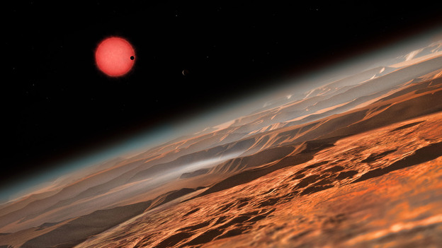 This artist's rendering shows what the view might look like from one of the three planets orbiting an ultracool, reddish dwarf star just 40 light-years from Earth. (ESO/M. Kornmesser/Nature)