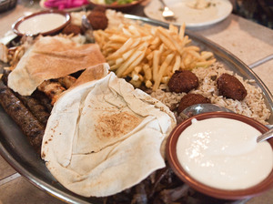 "A platter of falafel, kafta, french fries and other fare at Al Ameer Restaurant in Dearborn, Mich. The Mediterranean eatery will be recognized by the James Beard Awards this year in the ""American Classics"" category."