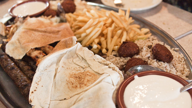 "A platter of falafel, kafta, french fries and other fare at Al Ameer Restaurant in Dearborn, Mich. The Mediterranean eatery will be recognized by the James Beard Awards this year in the ""American Classics"" category. (Edsel Little/Flickr)"