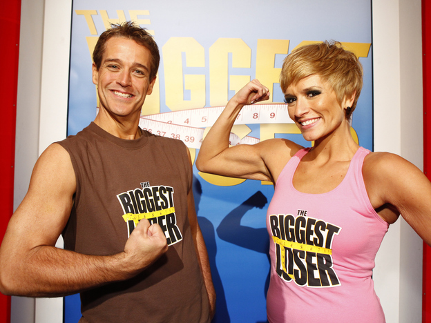 """Danny Cahill (left) won Season 8 of <em>The Biggest Loser</em> in 2009 by losing an amazing 239 pounds. He's pictured with at-home prize winner Rebecca Meyer. In the years since, Cahill has put back on more than 100 pounds, <a href=""""http://www.nytimes.com/2016/05/02/health/biggest-loser-weight-loss.html?smid=fb-share&_r=0"""">he told</a> <em>The New York Times.</em>"""
