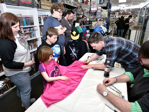 Batman Writer Scott Snyder signs autographs for DC Comics' Free Comic Book Day Special Issue at Fourth World Comics in 2015 in Smithtown, New York.