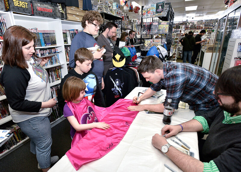 Batman Writer Scott Snyder signs autographs for DC Comics' Free Comic Book Day Special Issue at Fourth World Comics in 2015 in Smithtown, N.Y.