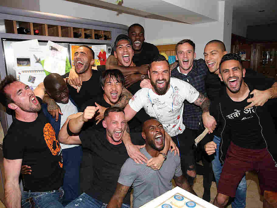 Leicester City players who had gathered at Jamie Vardy's house to watch title rivals Tottenham, play Chelsea, celebrate after clinching the trophy.