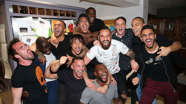 Leicester City players who had gathered at Jamie Vardy's house to watch title rivals Tottenham, play Chelsea, celebrate after clinching the trophy. (Getty Images)