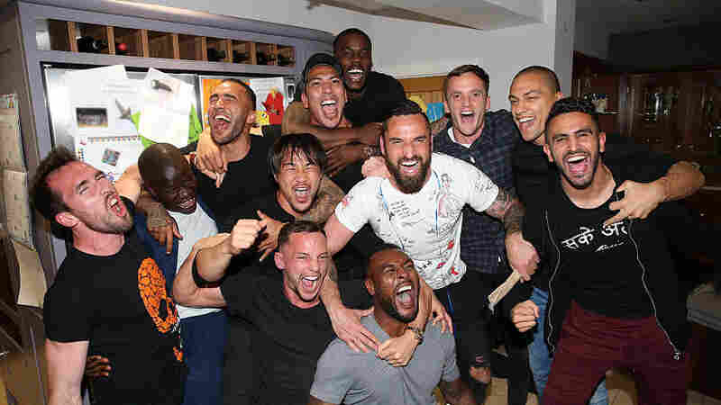 Leicester City players who had gathered at Jamie Vardy's house to watch title rival Tottenham play Chelsea celebrate after clinching the trophy.