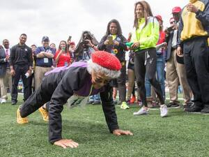 Ida Keeling does pushups after breaking the world record for the 100-meter dash for centenarians at Penn Relays in Philadelphia on Saturday.