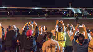 Spectators turned out to watch the Solar Impulse 2 solar airplane land at Phoenix Goodyear Airport on Monday night.