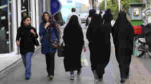 Women stroll on a Tehran street. Iranians are bracing themselves for extra scrutiny of their dress and behavior when a new, undercover morality police squad is deployed.