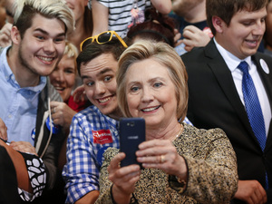 Democratic presidential candidate Hillary Clinton takes selfies with supporters at a campaign stop in Indianapolis, Sunday.