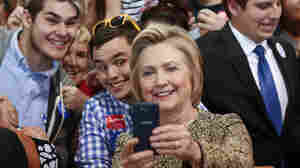 Democratic presidential candidate Hillary Clinton takes selfies with supporters at a campaign stop in Indianapolis on Sunday.