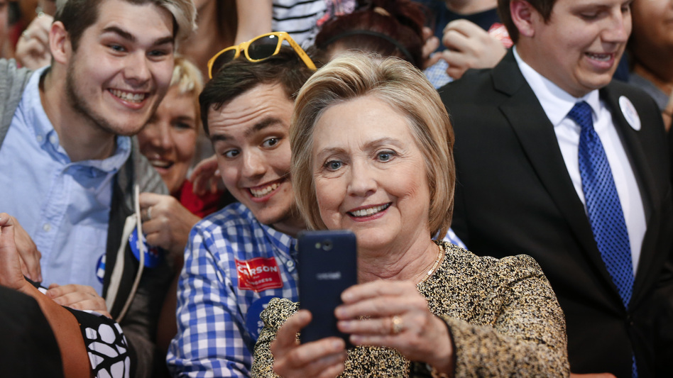 Democratic presidential candidate Hillary Clinton takes selfies with supporters at a campaign stop in Indianapolis on Sunday. (Paul Sancya/AP)
