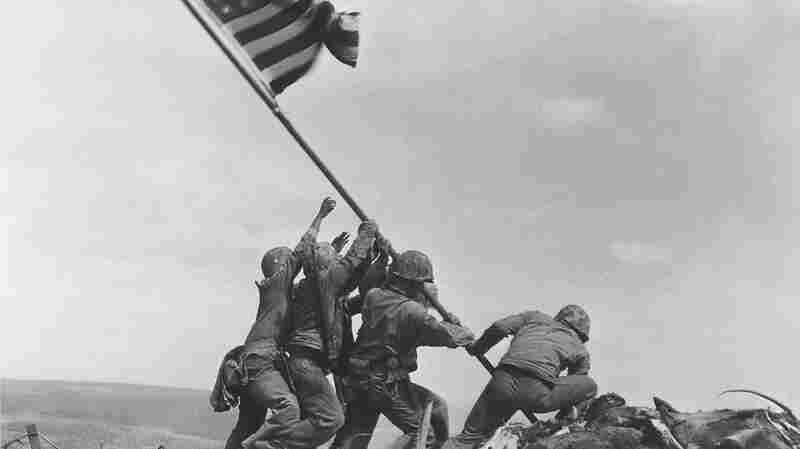 U.S. service members raise the American flag atop Mt. Suribachi in Iwo Jima, Japan, on Feb. 23, 1945. The Marine Corps is investigating whether some of the men in the photo have been misidentified.