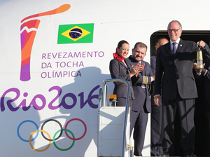Brazilian Olympic Committee president Carlos Nuzman shows the lantern containing the Olympic flame brought from Greece as he gets off the plane in Brasilia on May 3. The three-month torch relay across Brazil will end at the opening ceremony on Aug. 5 at Maracana stadium in Rio.