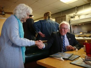 Madonna Rea shakes hands with Democratic presidential candidate Bernie Sanders as he has breakfast at Peppy Grill on Tuesday in Indianapolis, Indiana