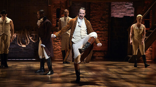 Actor and composer Lin-Manuel Miranda (center) performs on stage during a rehearsal of Hamilton ahead of the Grammy Awards in February in New York City. (WireImage/Getty Images)