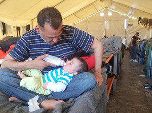 Moyaad Saad, a 43-year-old former civil servant from Baghdad, feeds his six-month-old daughter Zahara on their cot in a giant tent at a makeshift migrant camp near the border between Greece and Macedonia. Thousands of asylum seekers are now stuck here after several European countries closed their borders to them.