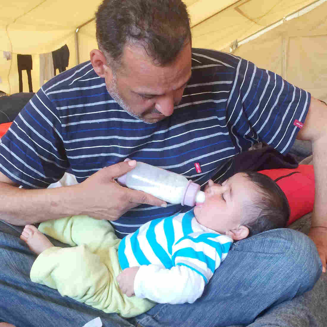 Moyaad Saad, a 43-year-old former civil servant from Baghdad, feeds his 6-month-old daughter Zahara on their cot in a giant tent at a makeshift migrant camp near the border between Greece and Macedonia. Thousands of asylum seekers are now stuck here after several European countries closed their borders to them.