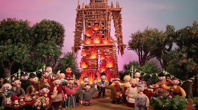 """Villagers burn a large figure made of wood in a scene from Radiohead's new animated video for the song """"Burn The Witch."""""""