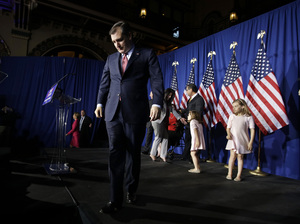 Republican presidential candidate, Ted Cruz, walks off the stage following a primary night campaign event Tuesday in Indianapolis.