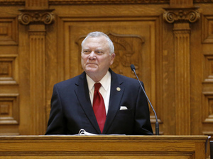 Gov. Nathan Deal says that a bill making it legal to carry guns in most buildings and areas at public colleges is too broad. He's seen here at the end of the General Assembly's session in March.