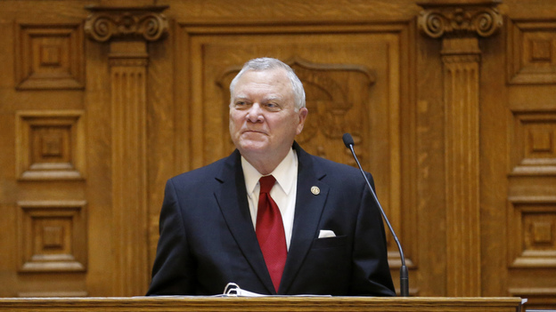 Gov. Nathan Deal says that a bill making it legal to carry guns in most buildings and areas at public colleges is too broad. He's seen here at the end of the General Assembly's session in March. (AP)
