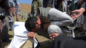 A relative weeps over the coffin of a victim killed in an  Taliban truck bomb attack, at a funeral in Kabul on April 20. The attack, which took place a day earlier, tore through central Kabul and a fierce firefight broke out.