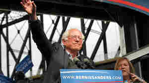 Democratic presidential candidate Bernie Sanders waves to the crowd after arriving Tuesday at a campaign rally at the Big Four Lawn Park in Louisville, Ky.